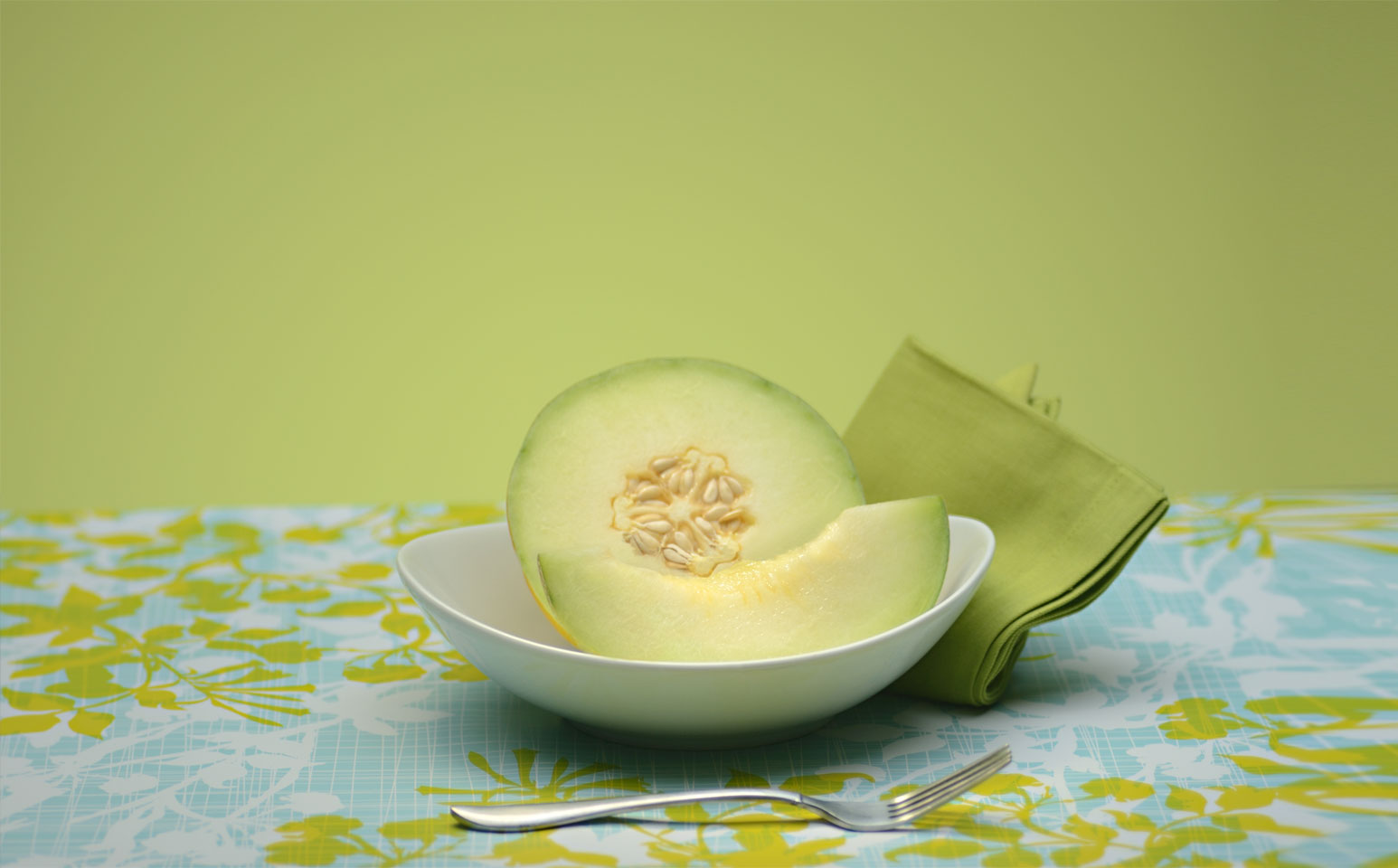 Sliced honeydew melon on a table